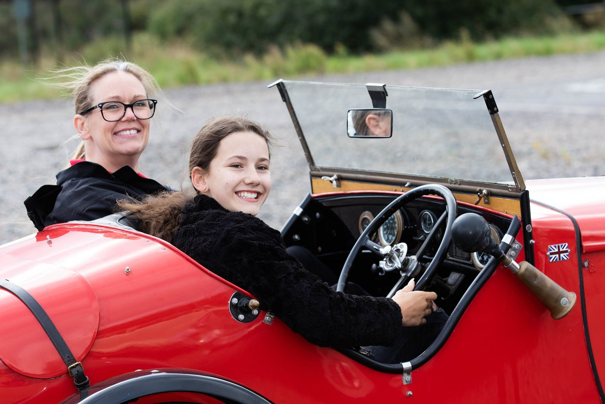 Ayoungsterdrivesthe1934Austin7UlsterReplicawithYoungDriver.jpg